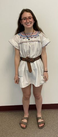Chris Moody, a Cheyenne Mountain Junior, shows us her adorable dress and Birkenstocks as she is starting to dress for summer time. Photo Credit: Merrill Delich